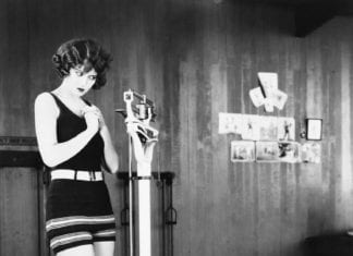 Vintage photo of a woman on weighing scales
