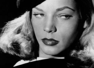 Actress Lauren Bacall dressed as a spy