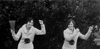 Vintage photo of cheerleaders practising their routine
